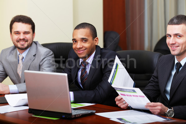 Stock photo: Multi ethnic business team at a meeting. Focus on african-american young man