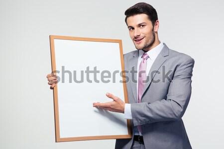 Stock fotó: Boldog · üzletember · bemutat · tábla · szürke · néz