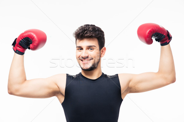 Happy winner boxer raising arms in the air Stock photo © deandrobot