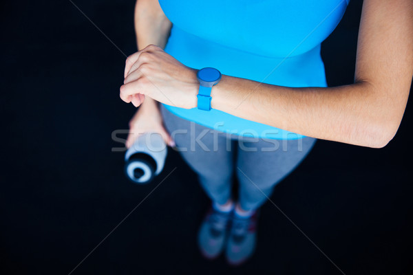 Woman with activity tracker Stock photo © deandrobot
