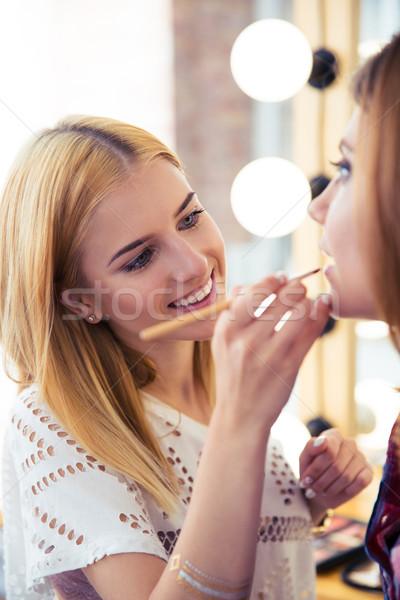 Woman applying makeup  Stock photo © deandrobot