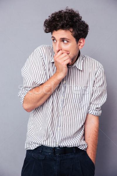 Adam korkmuş genç gri ağız Stok fotoğraf © deandrobot