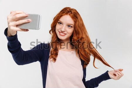 Student with backpack making selfie photo Stock photo © deandrobot
