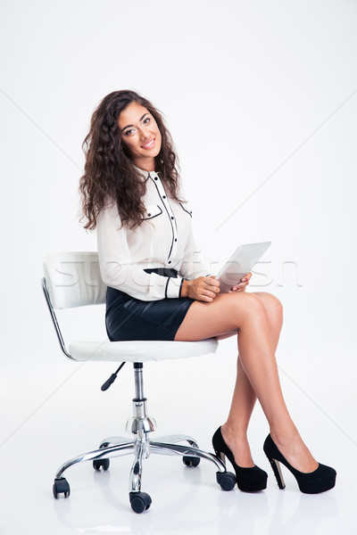 Femme d'affaires séance chaise de bureau portrait souriant Photo stock © deandrobot
