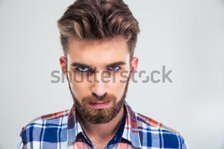Jóképű férfi szakáll néz kamera portré fiatal Stock fotó © deandrobot