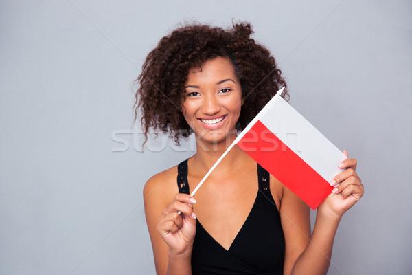 Afro amerykański kobieta Polska banderą Zdjęcia stock © deandrobot