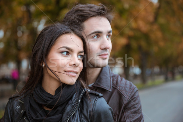 Couple looking away outdoors Stock photo © deandrobot