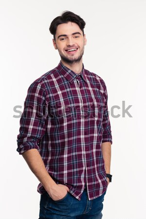 Portrait of a smiling casual man looking at camera Stock photo © deandrobot