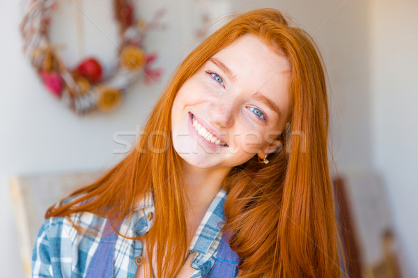 Portrait of beautiful happy young woman with long red hair  Stock photo © deandrobot