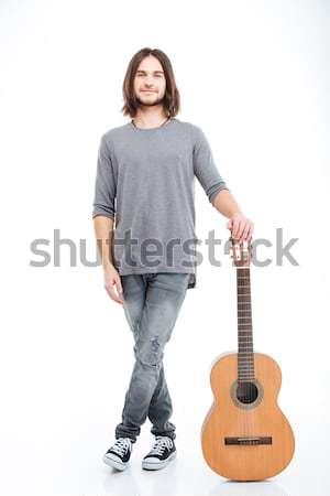 улыбаясь привлекательный молодым человеком Постоянный гитаре Сток-фото © deandrobot