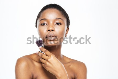 Afro american woman holding makeup brush Stock photo © deandrobot