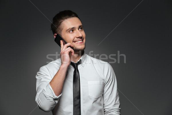 Alegre empresario blanco camisa hablar teléfono móvil Foto stock © deandrobot