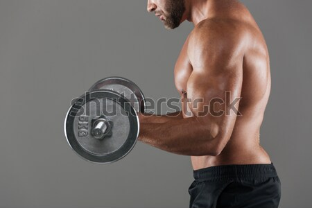 Healthy fitness man prepares to do excercises with a barbell Stock photo © deandrobot