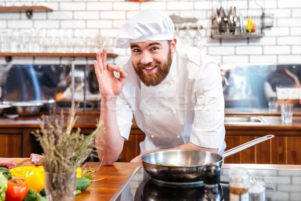 Sakallı şef pişirmek pişirme Stok fotoğraf © deandrobot