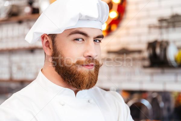 Glimlachend bebaarde chef kok keuken Stockfoto © deandrobot