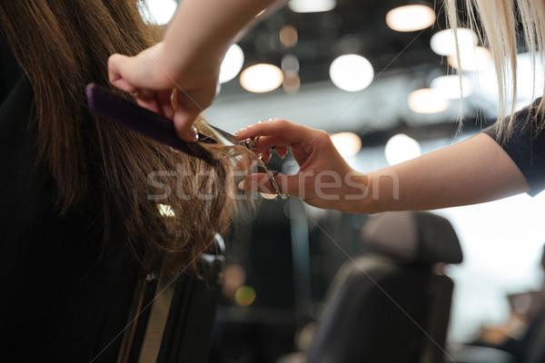 Professional hairdresser making stylish haircut Stock photo © deandrobot