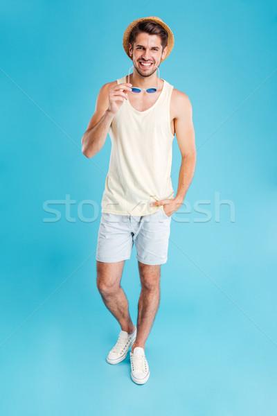 Genç şapka şort güneş gözlüğü Stok fotoğraf © deandrobot