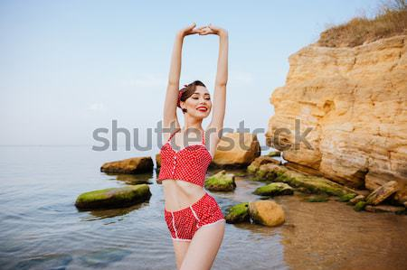 Pin up girl with pineapple on her head wearing swimsuit Stock photo © deandrobot