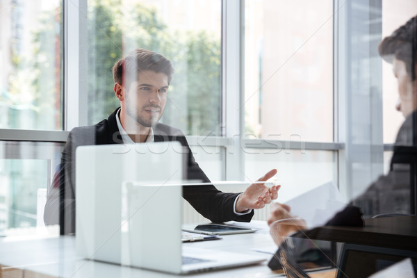Two businessmen with laptop on business meeting Stock photo © deandrobot