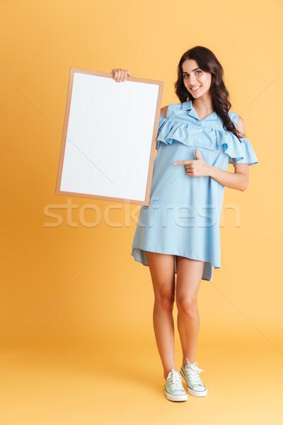 女性 青 ドレス ポインティング 指 ストックフォト © deandrobot