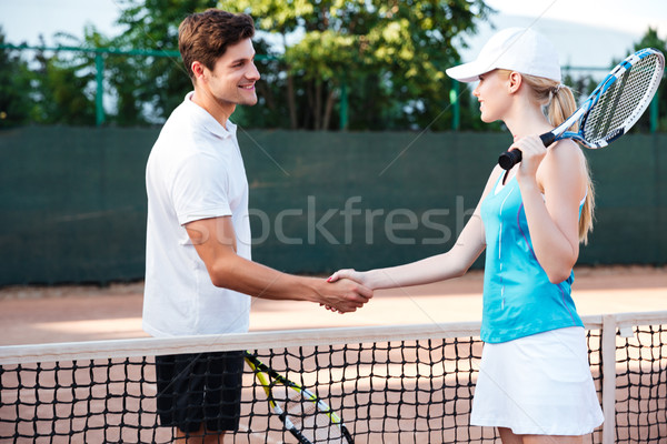 Portrait of tennis players Stock photo © deandrobot