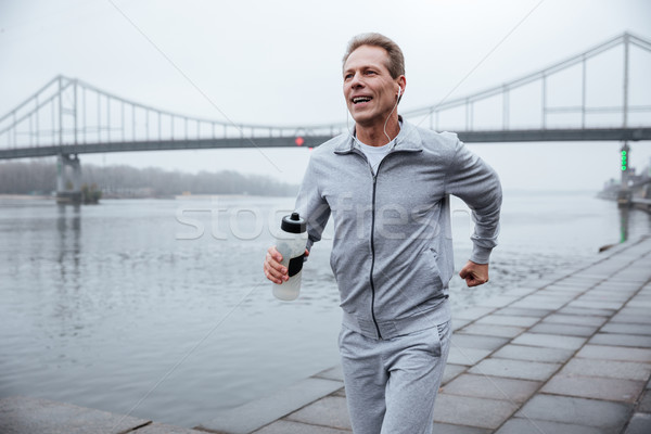 Man running with bottle of water Stock photo © deandrobot