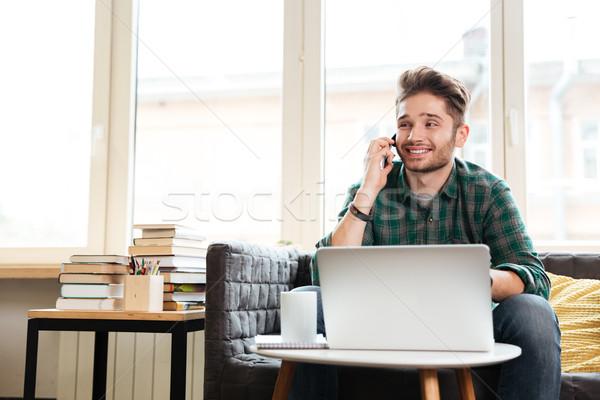 Man talking on phone in office Stock photo © deandrobot