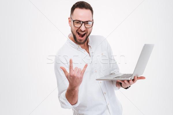 Feliz jovem barbudo homem laptop Foto stock © deandrobot