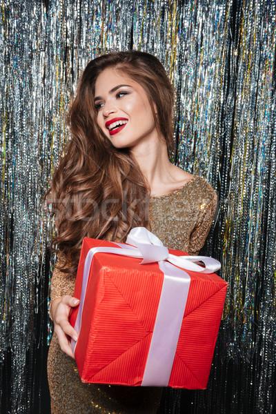 Feliz mulher vestido de noite em pé caixa de presente Foto stock © deandrobot