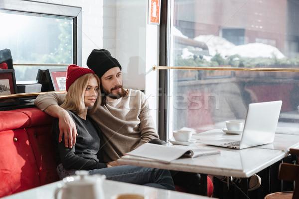 Zijaanzicht hipsters naar laptop vergadering tabel Stockfoto © deandrobot