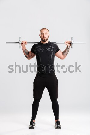 Happy bodybuilder Stock photo © deandrobot