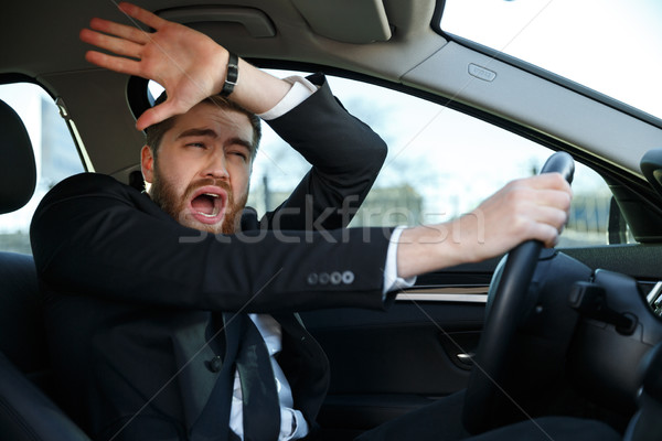 Screaming businessman nearly crashing car during his trip Stock photo © deandrobot