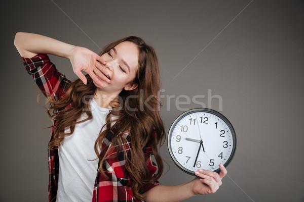 Fáradt fiatal hölgy tart óra ásít Stock fotó © deandrobot