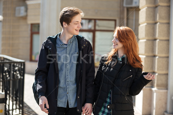 Cute couple walking after lessons Stock photo © deandrobot
