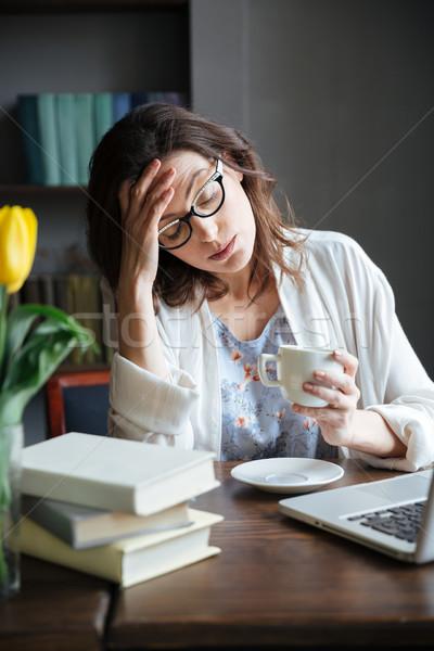 Fáradt kimerült érett nő szemüveg dől kéz Stock fotó © deandrobot