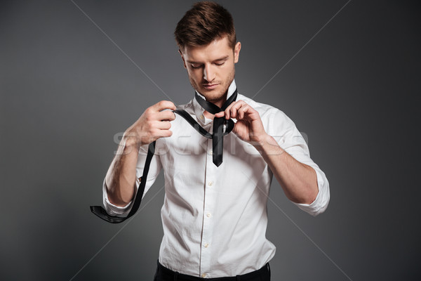 Handsome young man dressed in formalwear Stock photo © deandrobot