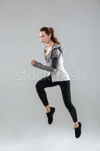 Vertical image of sports woman running Stock photo © deandrobot
