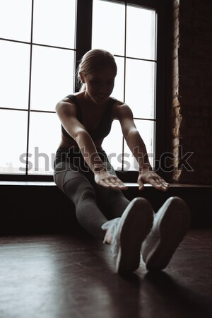 Portrait of a healthy young sportsman meditating in lotus pose Stock photo © deandrobot
