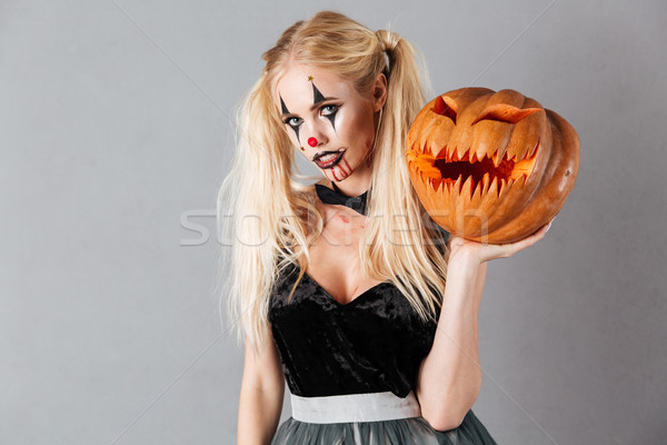 Young blonde woman in halloween clown make-up Stock photo © deandrobot