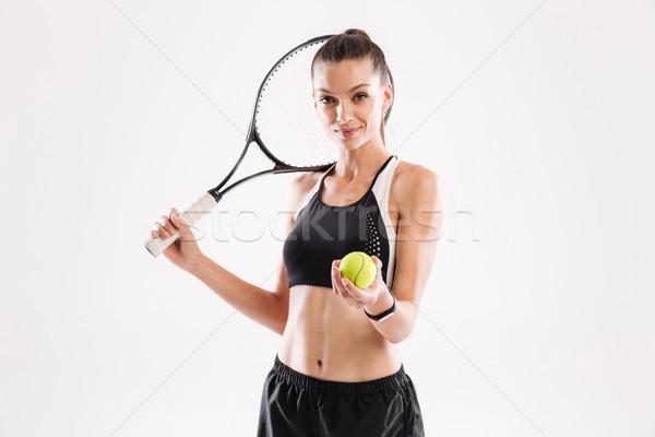 Portré mosolyog csinos nő teniszező tart ütő Stock fotó © deandrobot