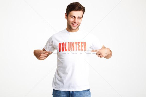 Portrait of a smiling confident man wearing volunteer t-shirt Stock photo © deandrobot
