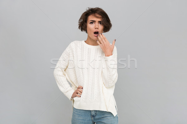 Portrait of a shocked girl in sweater Stock photo © deandrobot