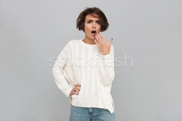 Portré megrémült lány pulóver befogja száját kéz Stock fotó © deandrobot