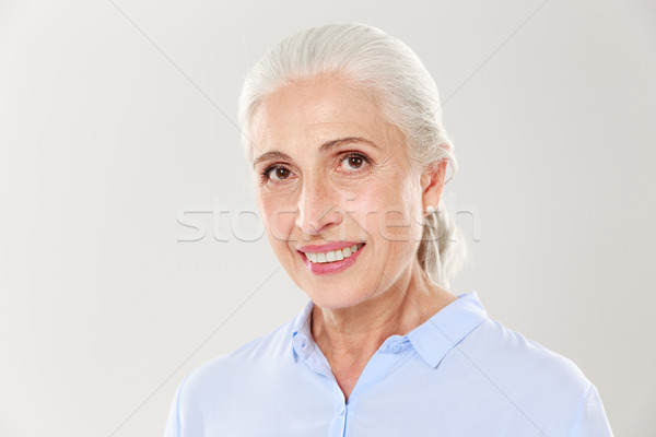 Close-up portrait of beautiful smiling old woman in blue shirt,  Stock photo © deandrobot