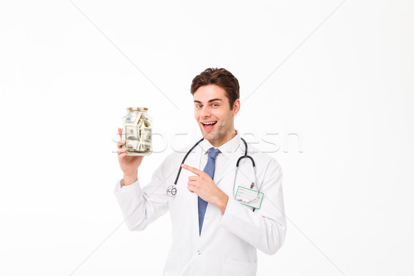 Portrait of an excited happy male doctor Stock photo © deandrobot