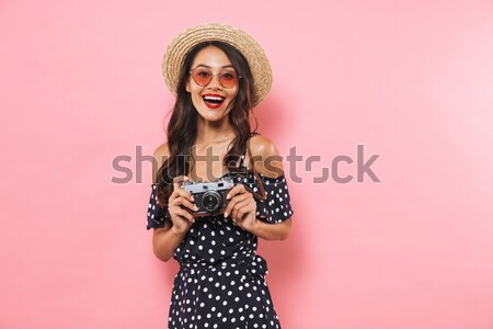 Close up portrait of a pretty woman in summer hat Stock photo © deandrobot