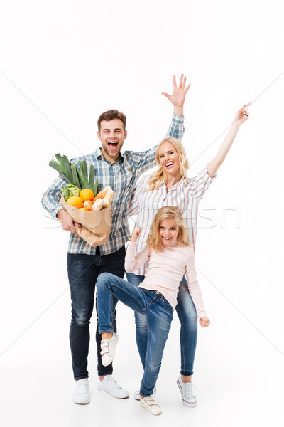 Full length portrait of an excited family Stock photo © deandrobot