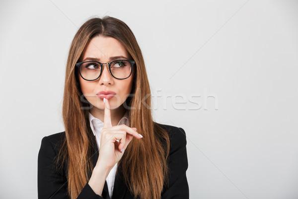 Portrait of a pensive businesswoman dressed in suit Stock photo © deandrobot