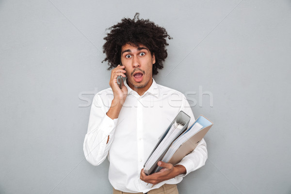 Portrait of a frightened young afro american man Stock photo © deandrobot