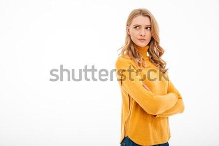 Cute jonge nadenkend dame permanente geïsoleerd Stockfoto © deandrobot